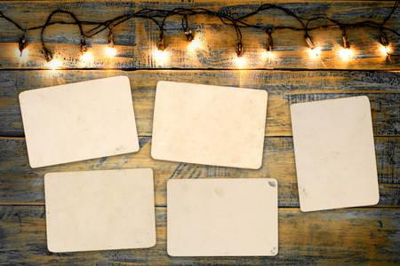 Blank photo frame album - empty old instant photos paper on wood table in Christmas Banco de Imagens