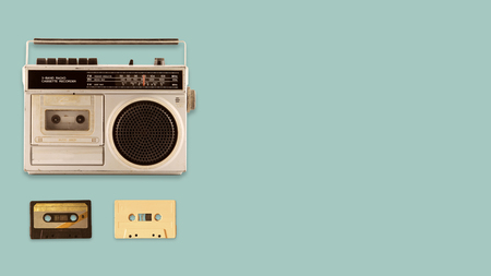 Radio cassette recorder and player with music tape cassette on color background. retro technology. flat lay, top view hero header. vintage color styles. Stock Photo