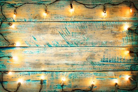 Christmas lights bulb on wood table. Merry christmas (xmas) background. topview, border design - rustic and vintage styles  Imagens