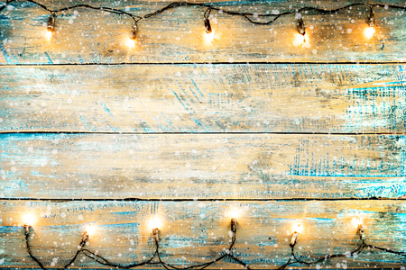 Christmas lights bulb on wood table. Merry christmas (xmas) background. topview, border design - rustic and vintage styles