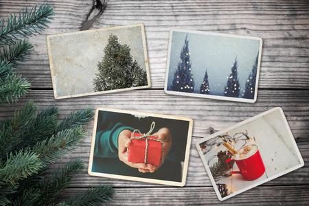 Lbum de fotos en recuerdo y nostalgia en Navidad (temporada de invierno) en la mesa de madera. foto de la cámara retro - estilo vintage y retro, topview Foto de archivo - 86551367