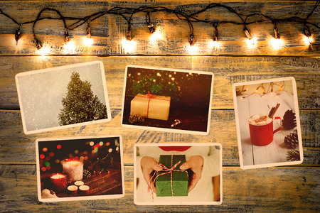 Photo album in remembrance and nostalgia in Christmas (winter season) on wood table. photo of retro camera - vintage and retro style, topview Stock Photo