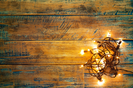 Christmas lights bulb on wood table. Merry christmas (xmas) background - rustic and vintage styles