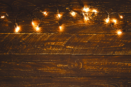 christmas lights bulb on wood table merry christmas xmas background topview