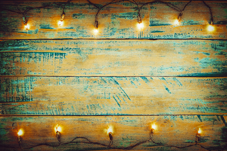 Christmas lights bulb on wood table. Merry christmas (xmas) background. topview, border design - rustic and vintage styles  Stock Photo