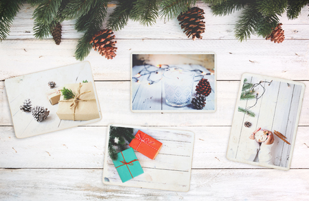 Photo album in remembrance and nostalgia in Christmas (winter season) on wood table. photo of retro camera - vintage and retro style, topview 스톡 콘텐츠