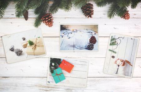 Album photo en souvenir et nostalgie de Noël (saison d'hiver) sur une table en bois. photo d'un appareil photo rétro - style vintage et rétro, vue de dessus