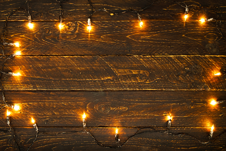 Christmas lights bulb on wood table. Merry christmas (xmas) background. topview, border design - rustic and vintage styles  Reklamní fotografie