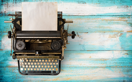 Vintage typewriter header with old paper. retro machine technology - top view and creative flat lay design. Stock Photo - 94289421
