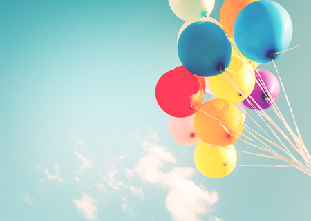 Colorful balloons done with a retro filter effect. Concept of happy birth day in summer and wedding, honeymoon party use for background. Vintage color tone style Stock Photo
