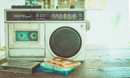 Retro lifestyle - tape cassette with cassette player and recorder for listen music - vintage color tone effect.