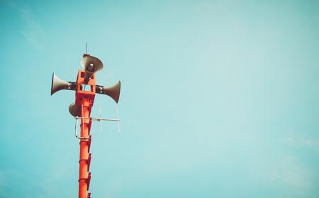 vintage horn speaker - public relations sign and symbol. vintage color tone effect Foto de archivo
