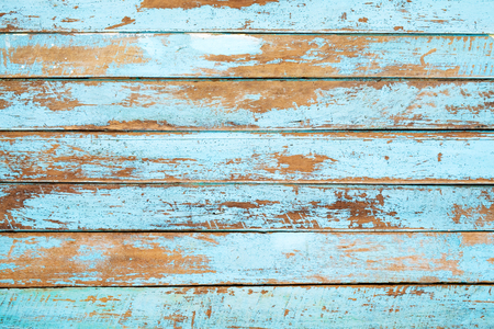 Vintage beach wood background - Old weathered wooden plank painted in blue color.