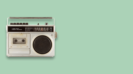 Radio cassette recorder and player on color background. retro technology. flat lay, top view hero header. vintage color styles. 版權商用圖片