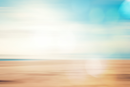 A seascape abstract beach background. panning motion blur and bokeh light of lens flare, pastel colors in a vintage and retro style.