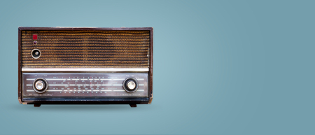 Vintage radio on color background. retro technology. flat lay, top view hero header. vintage color styles.