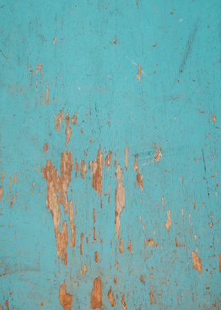 Vintage background of beach wood. Old and weathered wood with blue paint background.