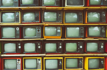 Pattern wall of pile vintage television (TV) - vintage filter effect style. retro technology.