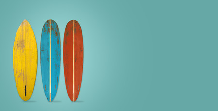 Vintage surfboard on color background. flat lay, top view hero header. vintage color styles. Stock Photo