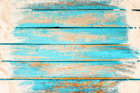 Beach background - top view of beach sand on old wood plank in blue sea paint background. summer vacation concept. vintage color tone. Фото со стока