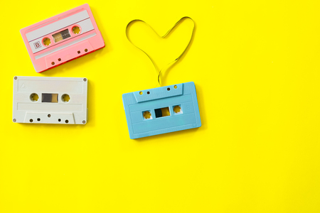 vintage tape cassette recorder on yellow background, flat lay, top view. retro technology 写真素材