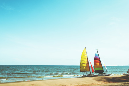 Colorful sailboat on tropical beach in summer. Stock Photo - 100981391