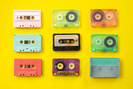 Set of vintage tape cassette recorder on yellow background, flat lay, top view. retro technology Stockfoto