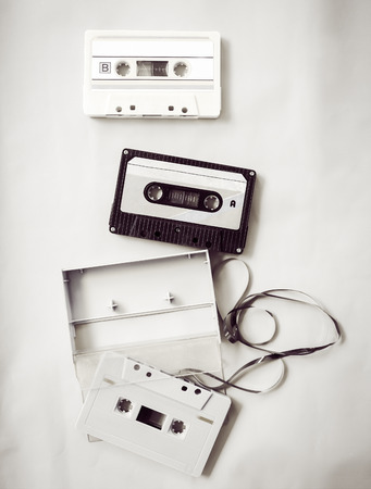 High-key lighting of black and white vintage tape cassette recorder, flat lay, top view. retro technology 写真素材 - 102524229
