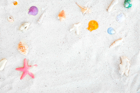 Beach background - top view of beach sand with shells and starfish. summer background concept.