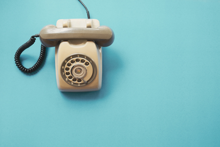 vintage telephone on blue background, flat lay, top view. retro technology Banco de Imagens - 103199177