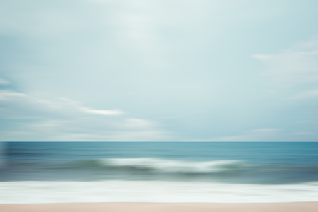 A seascape abstract beach background. panning motion blur with a long exposure, pastel colors in a vintage and retro style.