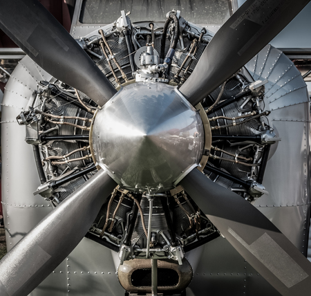 Close up vintage aircraft engine and propeller. HDR