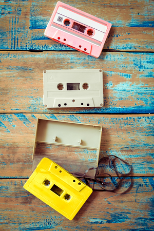 vintage tape cassette recorder on wood background, flat lay, top view. retro technology 版權商用圖片