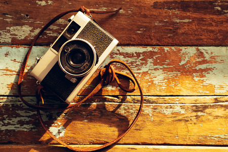 Photo of nostalgia - vintage film camera on old wooden background Reklamní fotografie
