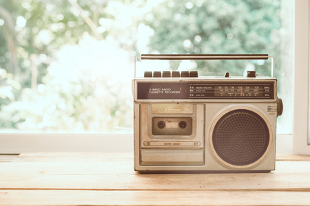 Photo of memorie and nostalgia. vintage radio or cassette reccorder in house. vintage color tone. 写真素材
