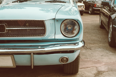 Headlight lamp of vintage car - vehicles vintage classic style. retro film color filter effect. 스톡 콘텐츠