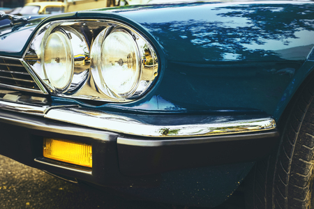 Headlight lamp of vintage car - vehicles vintage classic style. retro film color filter effect. 写真素材