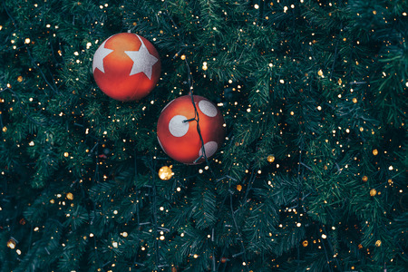 Vintage Christmas tree with red ball decoration and sparkle light. Christmas and New Year holiday background. vintage color tone. Stock Photo