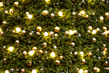 Vintage Christmas tree with gold ball ornament and sparkle light. Christmas and New Year holiday background. Stok Fotoğraf