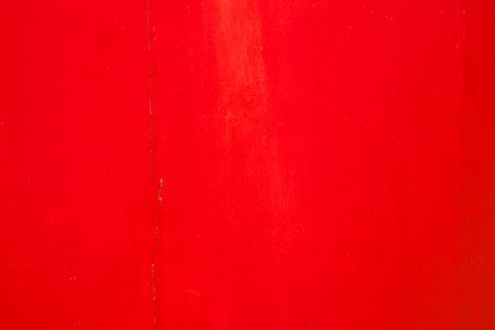 Red paint on wooden vintage background. Christmas red background.