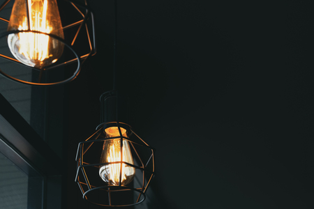 Beautiful vintage luxury light lamp hanging decor glowing in dark. Retro filter effect style.