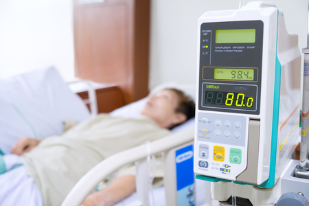 Senior asian woman patient with infusion pump treated in hospital. medical background