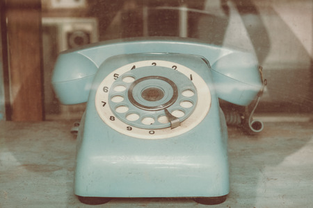 Vintage line telephone receiver, retro technology Stock Photo
