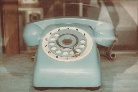 Vintage line telephone receiver, retro technology 写真素材