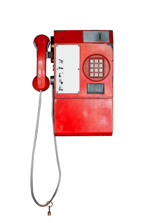Vintage public telephone isolated on white with clipping path for object.