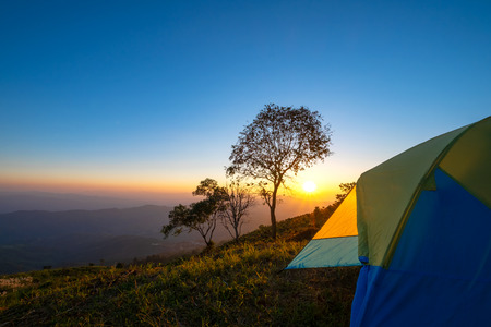 Landscape mountain at sunset with tent camping. Reklamní fotografie