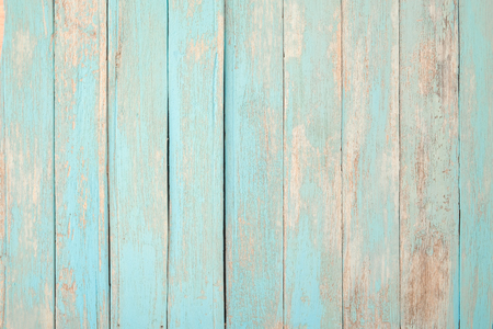 Vintage beach wood background - Old weathered wooden plank painted in turquoise blue pastel color. Stock Photo