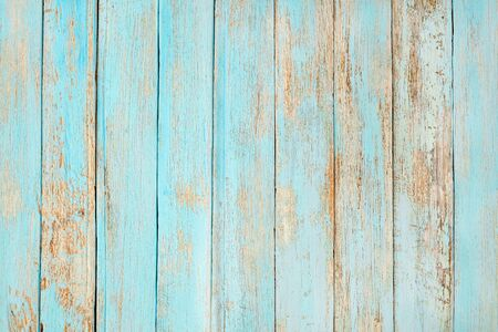 Vintage Old weathered wooden plank painted in turquoise blue pastel color.
