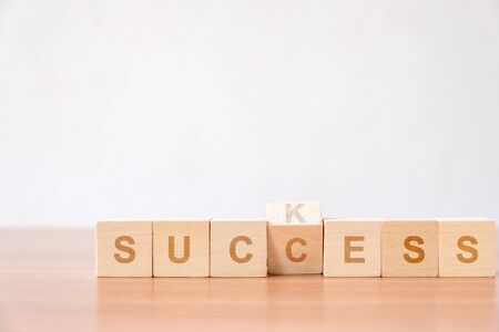 Concept of successful in business. flip changing letter on wood block from suck to success concept for improvement to successfully. 版權商用圖片