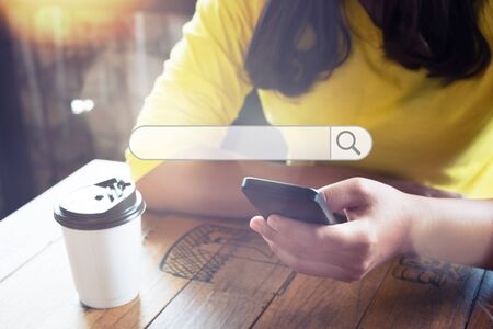 Searching information data on internet networking concept. Women use smartphones to search the internet, what they are interested in. Searching engine with blank search bar. Stock Photo - 129684506